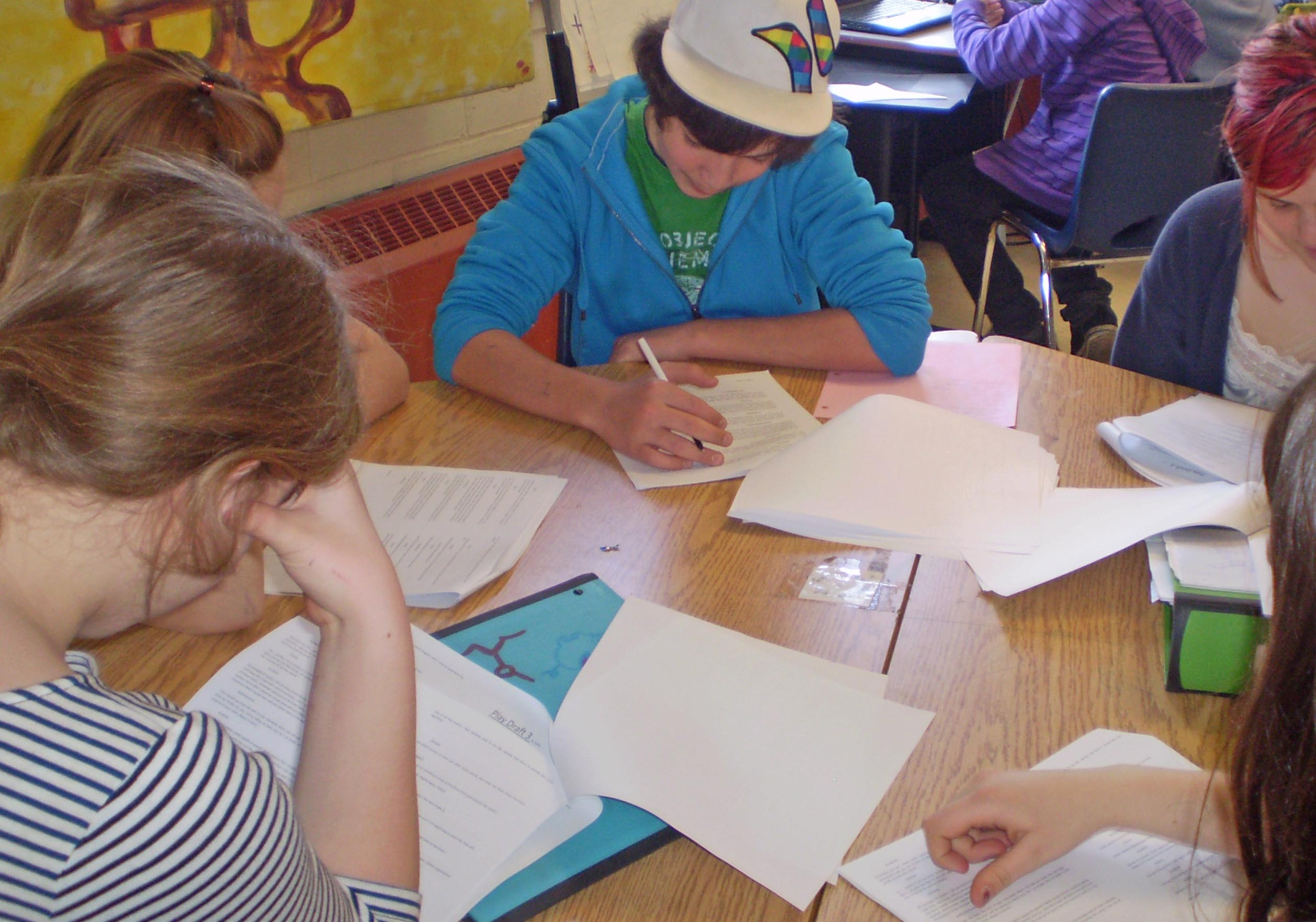 Students reading scripts