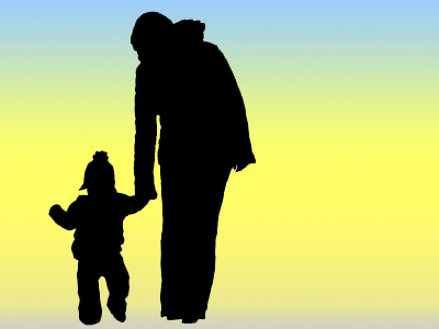 silhouette of parent holding child's hand