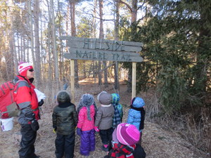 Students looking at Hillside Nature Sign