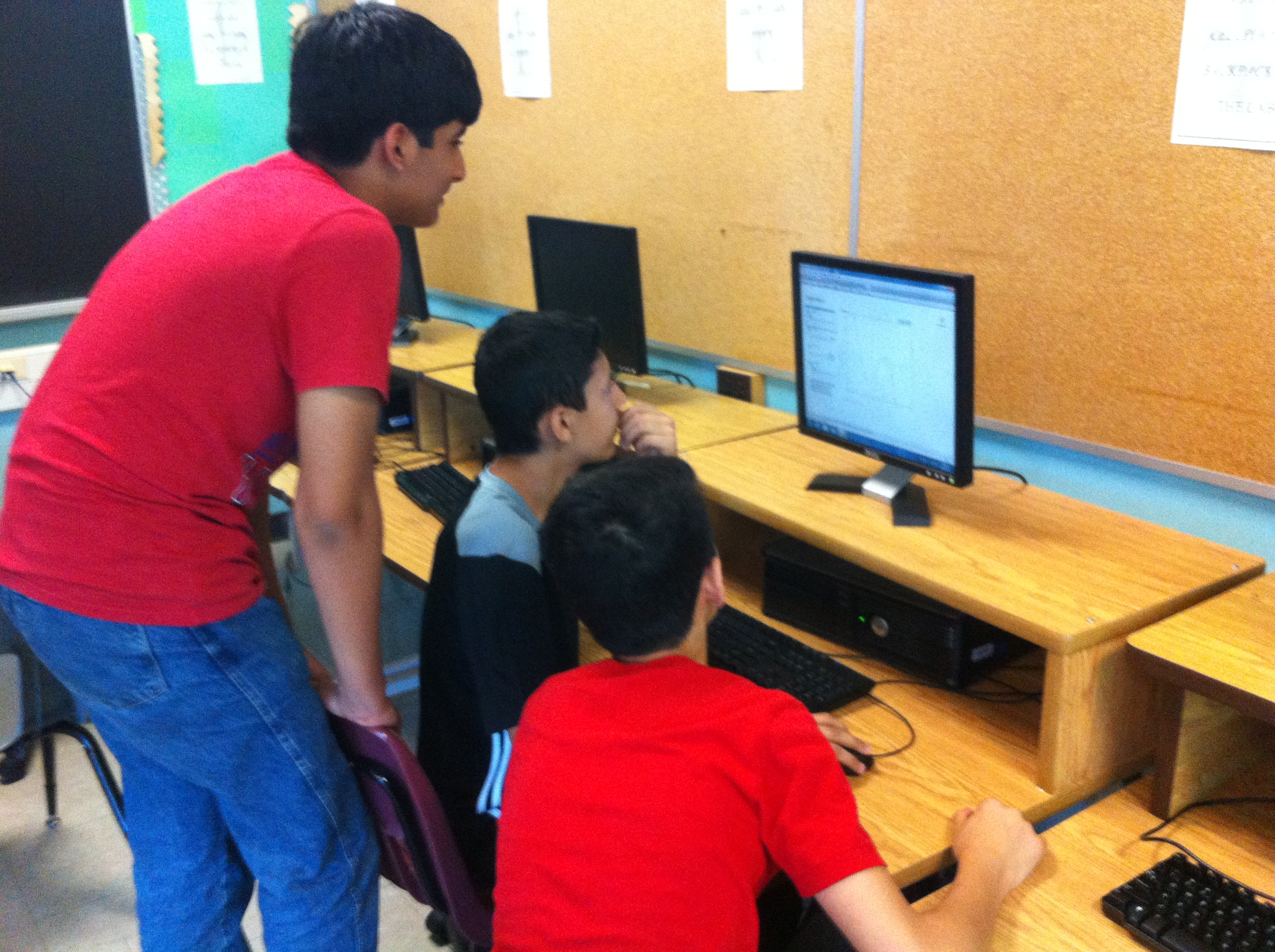 Picture of students using computer simulations