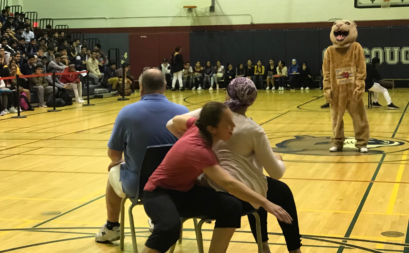 Photo of teachers playing musical chairs