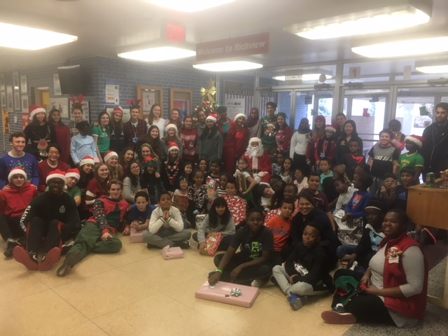 High School and Elementary students with Santa Claus