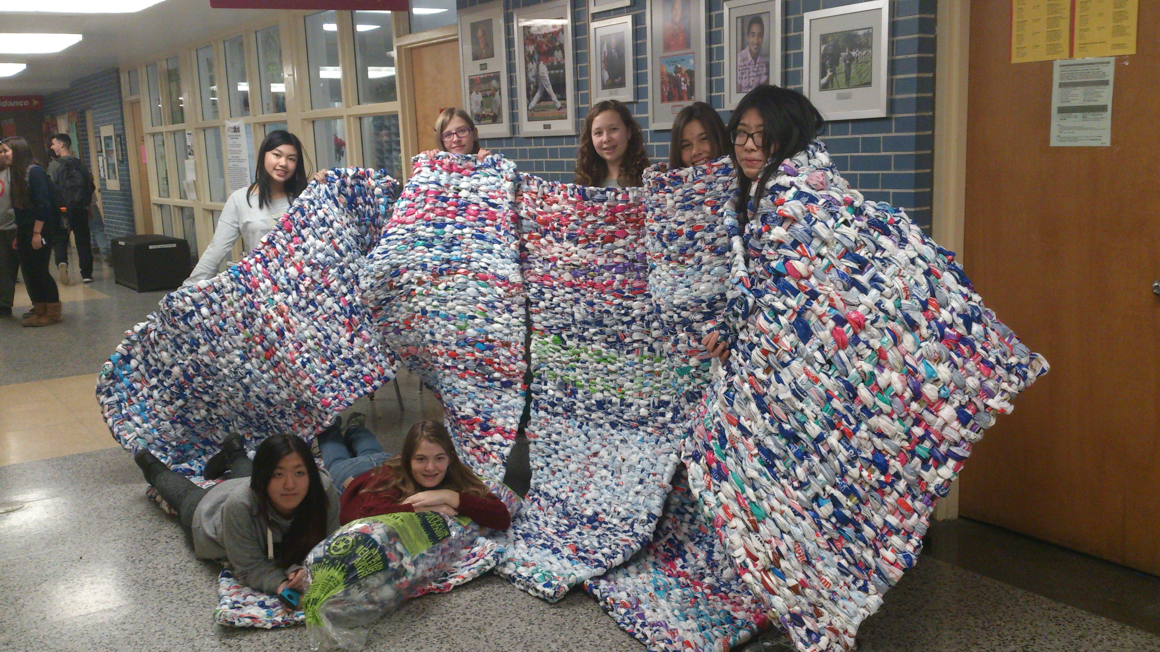 Students with milk bag mattresses