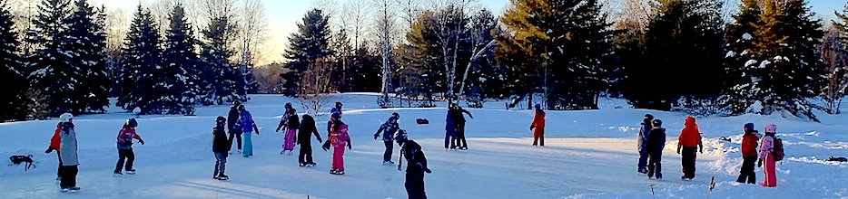 Students ice skating on the pond at SOES