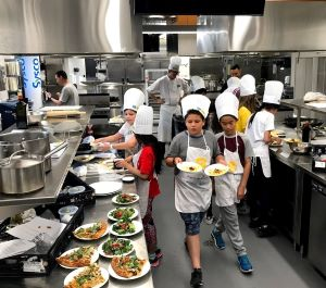 Waterfront students cooking in George Brown Cooking School Kitchen